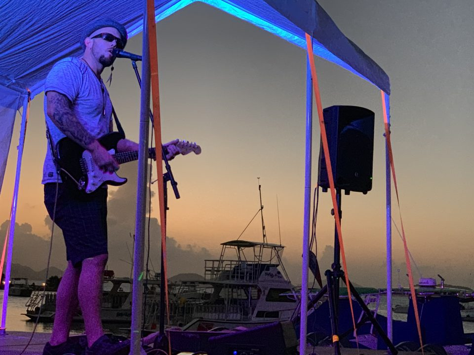 Music played under the tent at sunset